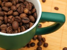 Coffee Beans In A Green Cup Royalty Free Stock Photo