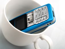 Free A Mobile Phone In A White Cup Stock Photos - 4642403