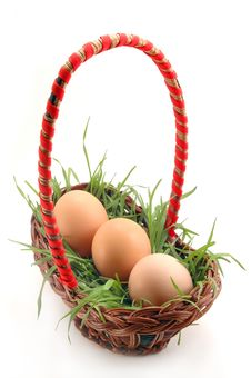 Basket With Grass And Eggs Royalty Free Stock Image