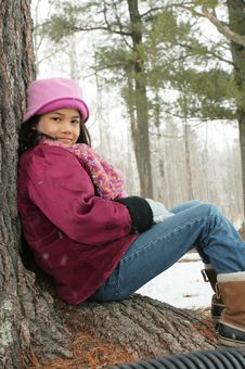 Child Sitting Under Tree Outdoors In Winter Royalty Free Stock Images