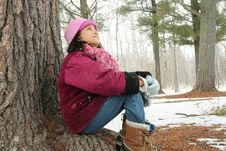 Nine Year Old Girl Sitting Outdoors In Winter Stock Image