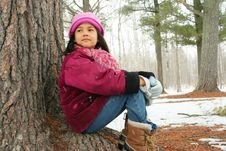 Nine Year Old Girl Sitting Outdoors In Winter Stock Photos