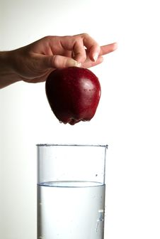 Free Human Hand Holding Apple Over Water Stock Photo - 4644740