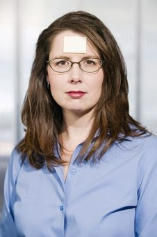 Businesswoman With A Blank Note On Her Forehead Stock Photo
