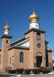 Free Brick Church Against A Blue Sky Royalty Free Stock Photos - 4656398