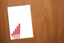 A4 Page With Graph On Wood Background Royalty Free Stock Photos