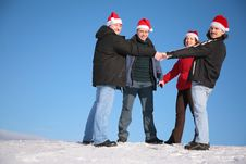 Free Four Friends On Snow In Santa Claus Hats Royalty Free Stock Images - 4660369