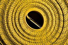 Curled Up Black And Yellow Measuring Tape Stock Photo