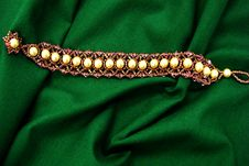 Free Bracelet On Green Background Royalty Free Stock Photography - 4662157