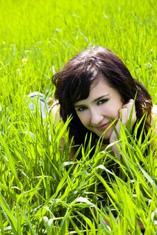 Free Smiling Beauty On Grass Royalty Free Stock Images - 4670129