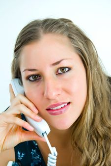 Young Lady With White Telephone Stock Photography