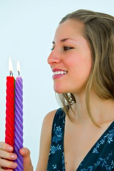 Young Lady Looking At Fire Of Candles Royalty Free Stock Images