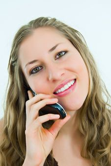 Smiling Pretty Lady With A Mobile Telephone Stock Image