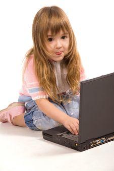Nice Little Girl With Laptop Stock Photos