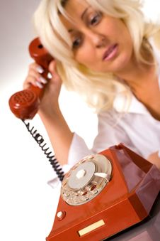 Blond Caucasian Model With Red Phone Stock Image