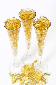 Free Three Glasses With Gold Boluses Stock Image - 4671101