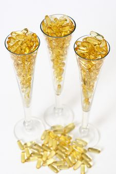 Free Three Glasses With Gold Boluses Royalty Free Stock Image - 4671106