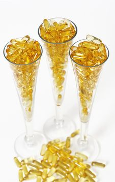 Free Three Glasses With Gold Boluses Royalty Free Stock Photo - 4671115