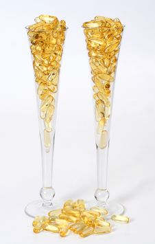 Free Two Glasses With Gold Boluses Stock Photos - 4671133