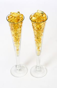 Free Two Glasses With Gold Boluses Royalty Free Stock Images - 4671139