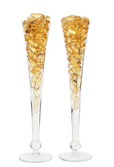 Free Two Glasses With Gold Boluses Stock Image - 4671141