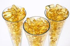 Free Three Glasses With Gold Boluses Royalty Free Stock Image - 4671146