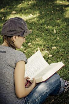 Free Young Enjoying A Book Royalty Free Stock Photos - 4672568