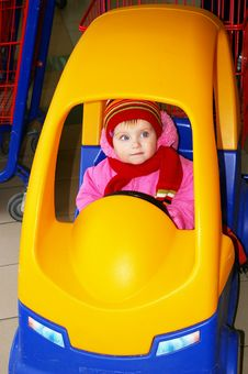 Little Girl In The Carriage In A Supermarket Stock Image