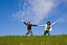 Free Two Arms Raised Friends In A Meadow Stock Image - 4676901