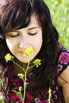 Free Young Woman Smelling Yellow Flower Royalty Free Stock Photo - 4676975