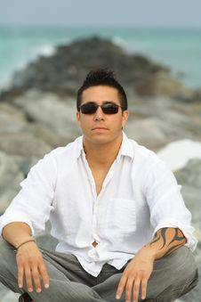 Free Man Sitting On The Rocks Stock Image - 4677351