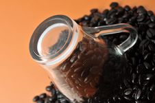 Glass Cup With Coffe Beans Royalty Free Stock Photos