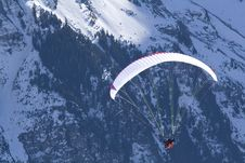 Free Paraglider Hovering In The Mountains. Royalty Free Stock Image - 4677746