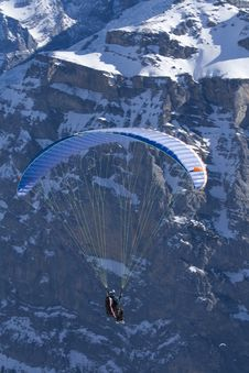 Free Paraglider Hovering Along The Cliffs Stock Photos - 4677753