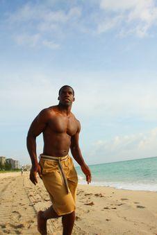 Man Running On The Beach Royalty Free Stock Photo