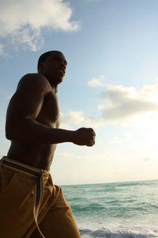 Free Man Running On The Beach Stock Photography - 4677802