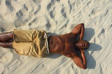 Free Man Laying On The Sand Royalty Free Stock Photography - 4677837