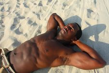 Free Man Laying On The Sand Stock Photography - 4677852