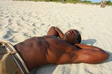 Free Man Laying On The Sand Stock Images - 4677854