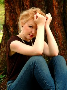 Young Woman By Cedar Tree Royalty Free Stock Photos