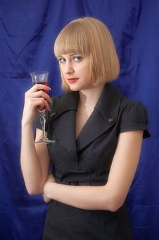 The Blonde With A Wine Glass Stock Image