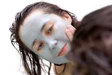 Girl Putting A Mud Mask Royalty Free Stock Image