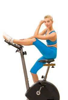 Woman On Exercise Bicycle Royalty Free Stock Image