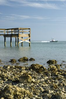 Free Pier Rocky Shoreline With Boat Stock Images - 4680554