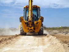 Free Backhoe Desert Cruising Royalty Free Stock Photography - 4688157