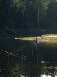 Free The Man Fishes In The Wood River Stock Photos - 4689353