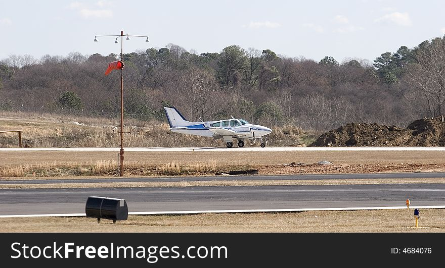 Blue and White Plane on Runway