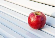 Free Red Apple On The Bench Royalty Free Stock Images - 46811439