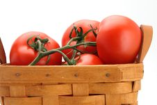 Tomatoes And Basket Stock Photo