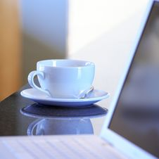 Laptop And Tea Cup Royalty Free Stock Photography